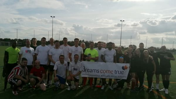 charity football group photo
